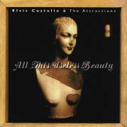 Обложка альбома All This Useless Beauty, Музыкальный Портал α